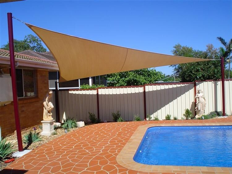 Cream shade sail near pool