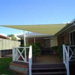 Cream shade sail over outdoor area