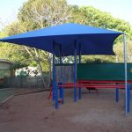 Blue shade structure over playground