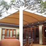 Cream shade structure over outdoor area