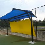 Blue and Yellow shade structure at sporting field