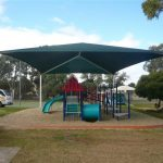 Green shade structure over playground