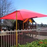 Red shade structure over playground