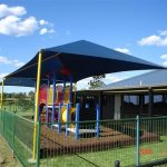 Blue and Yellow shade structure over playground