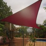 Red Shade Sail over residential Pool