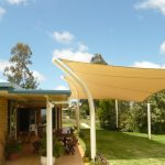 Cream Shade Sail near brick house Residential