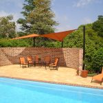 Orange Shade Sail Outdoor Area near pool