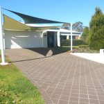 Shade Sail for Carport outside of brick house