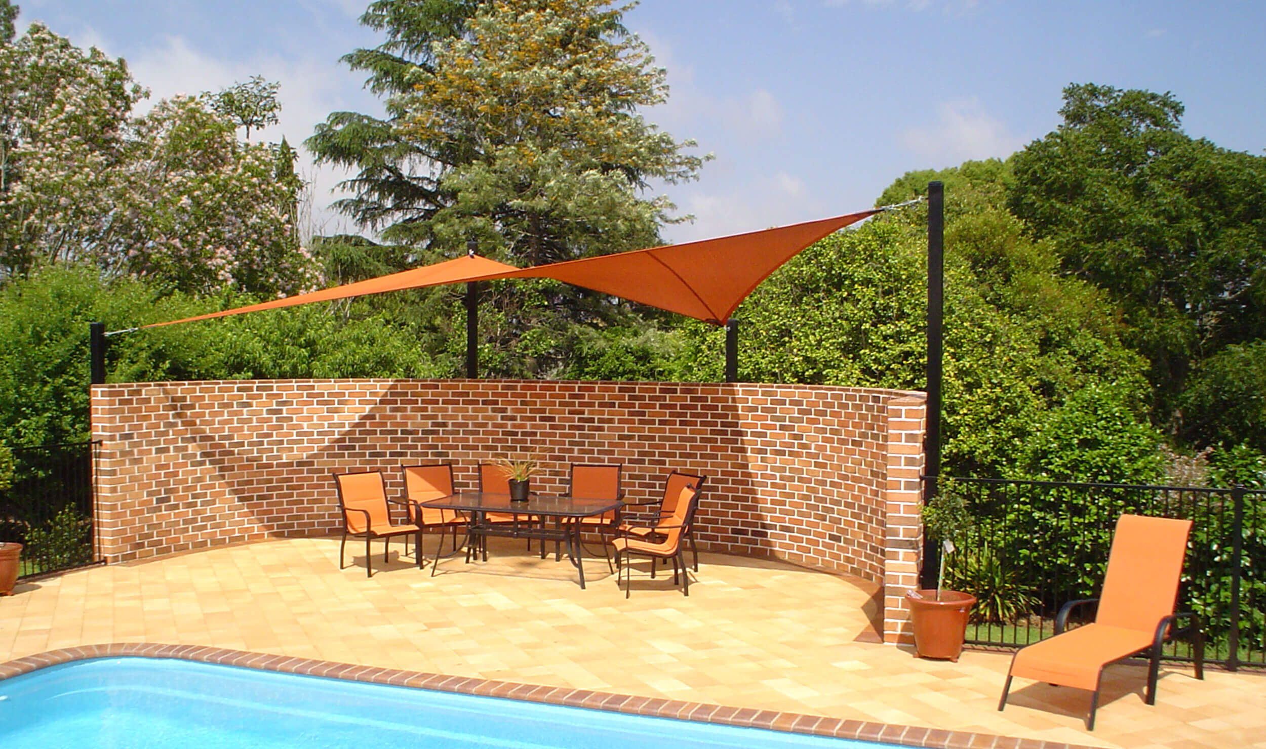 Orange Shade Sail near backyard pool