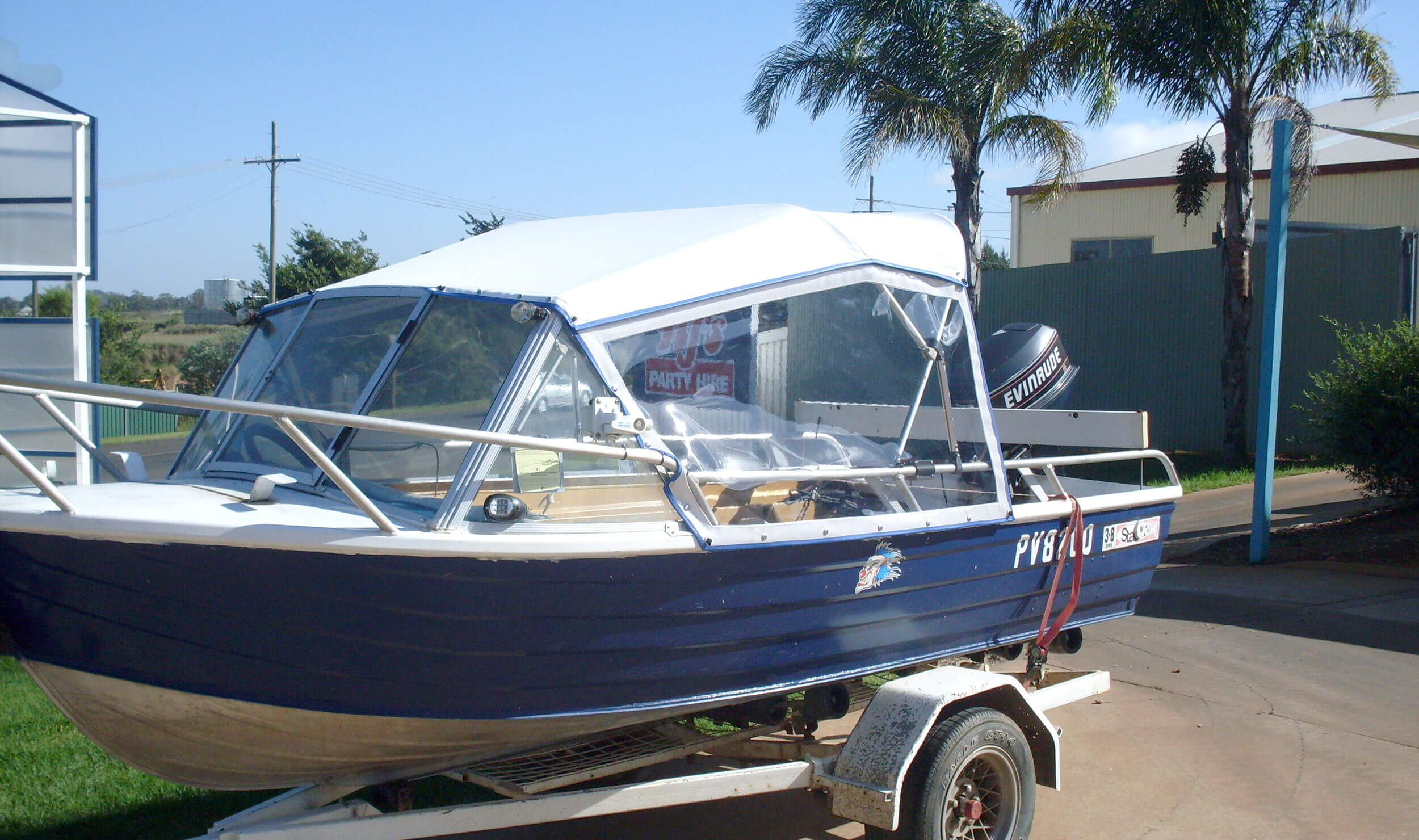 Blue and white boat with shade cover